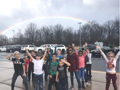 Several Erving students pointing to rainbow